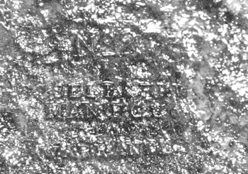 Stamped inscription preserved on iron hatchet blade.