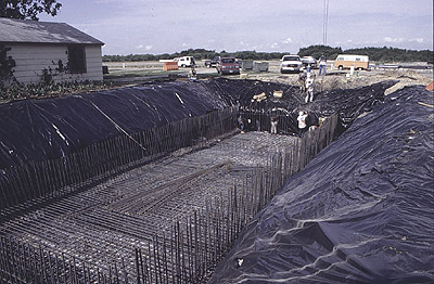 Reinforcing rods and plastic sheets in pit